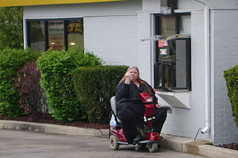 Fat woman. Scooter. Drive thru.